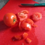 Cutting tomatos