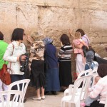 Woman in front of the wailing wall