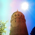 Galata tower with a bright and shiny sun